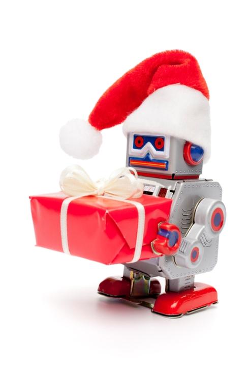Retro tin toy santa robot holding christmas present